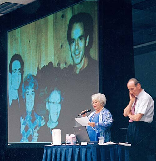 Judith Whitson and Kenneth Wapnick (projected photo of Ken, Judy, Helen and Bill behind them) speaking at Miracle Distribution Center conference