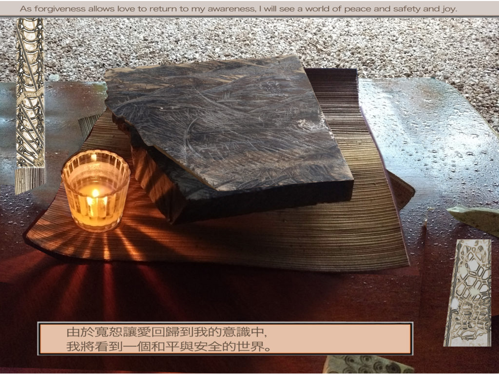 "Meditation graphic quote ""As forgiveness allows love to return to my awareness, I will see a world of peace and safety and joy."" – W-pI.55.3:3 also in Japanese(?) need characters with translation for alt text; lit votive candle next to slate/board with other textured elements"