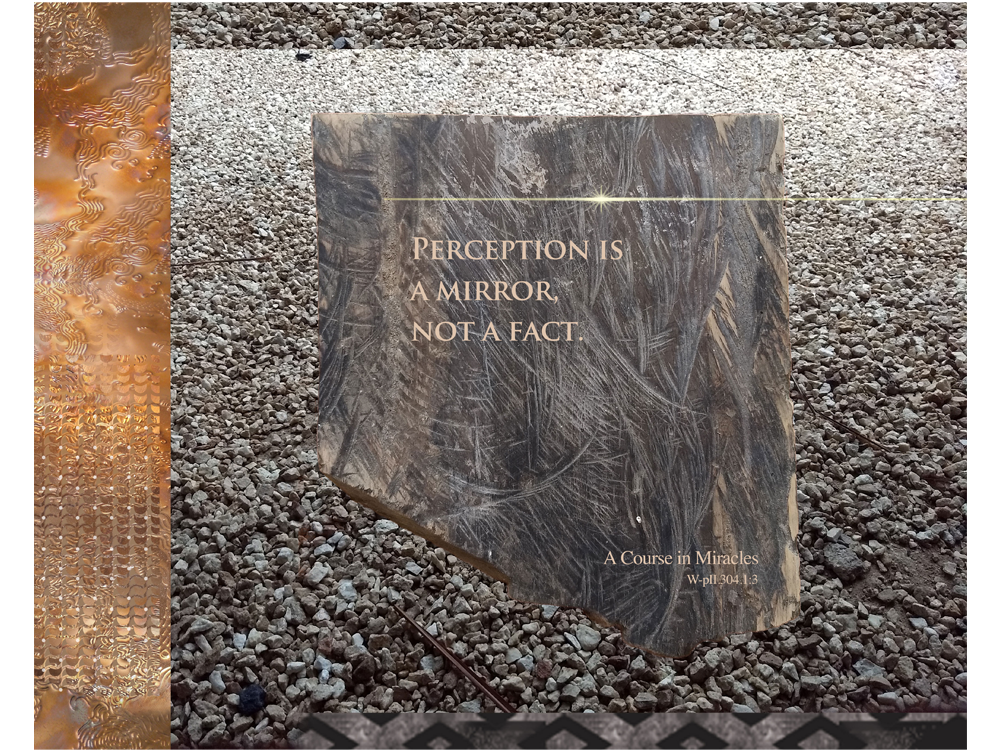 "Meditation graphic with quote: ""Perception is a mirror, not a fact."" – W-pII.304.1:3 – scratched slate-looking wood with horizontal starburst"